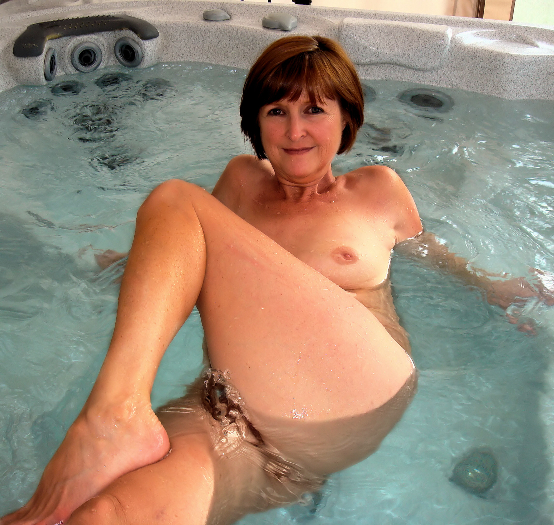 Naked redhead in hot tub #3